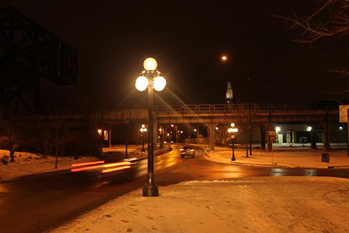 Waterfront Drive street lights and train bridge.