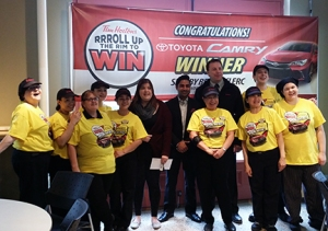 Tim Horton's staff and the manager from the Toyota dealership get in on pictures.